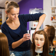 Pretty female hairdresser/haidressing apprentice/student trainin